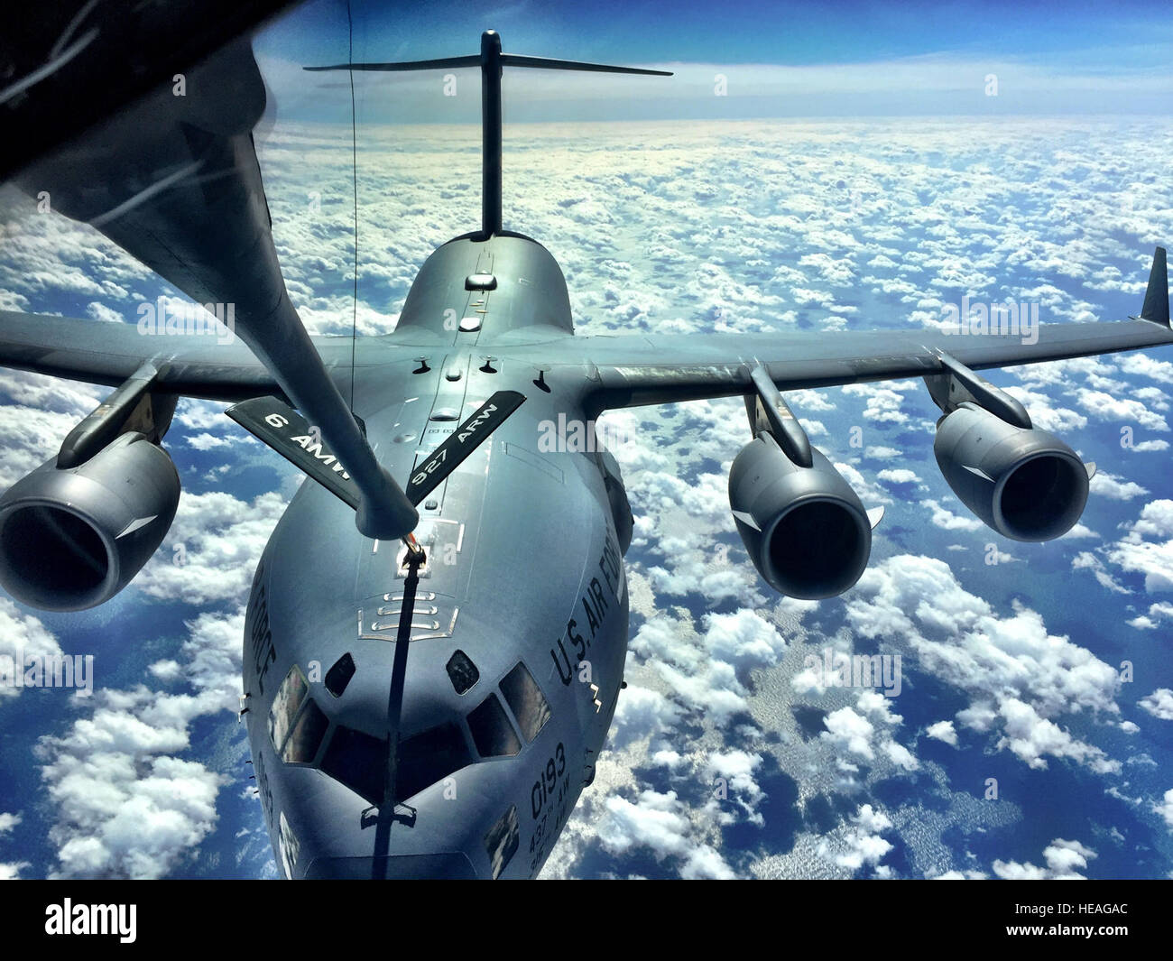 A C-17 Globemaster is refueled by a MacDill KC-135 Stratotanker during a pilot training mission off the coast of Stock Photo