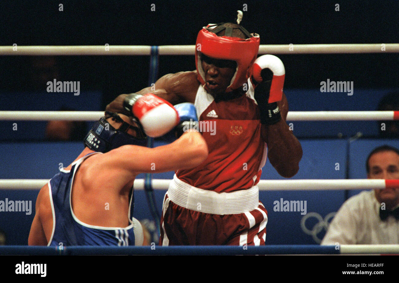 Straight on, medium shot of US Army Staff Sergeant Olanda Anderson (Red) as he tries to land a punch against Rudolf - Stock Image