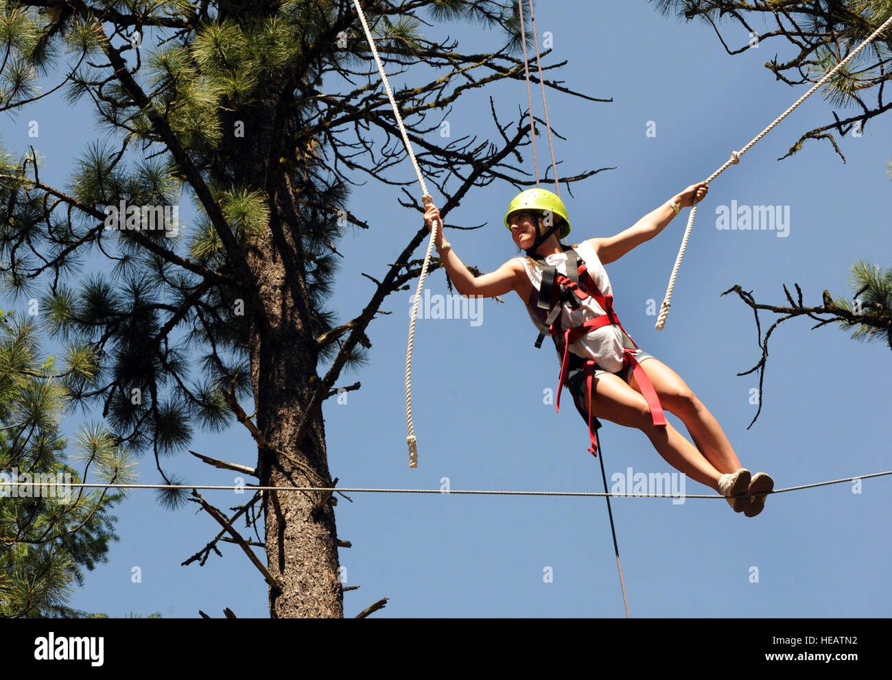 MOUNTAIN HOME AIR FORCE BASE, Idaho -- Allie Bashore, camp participant, makes her way across a high-ropes course - Stock Image