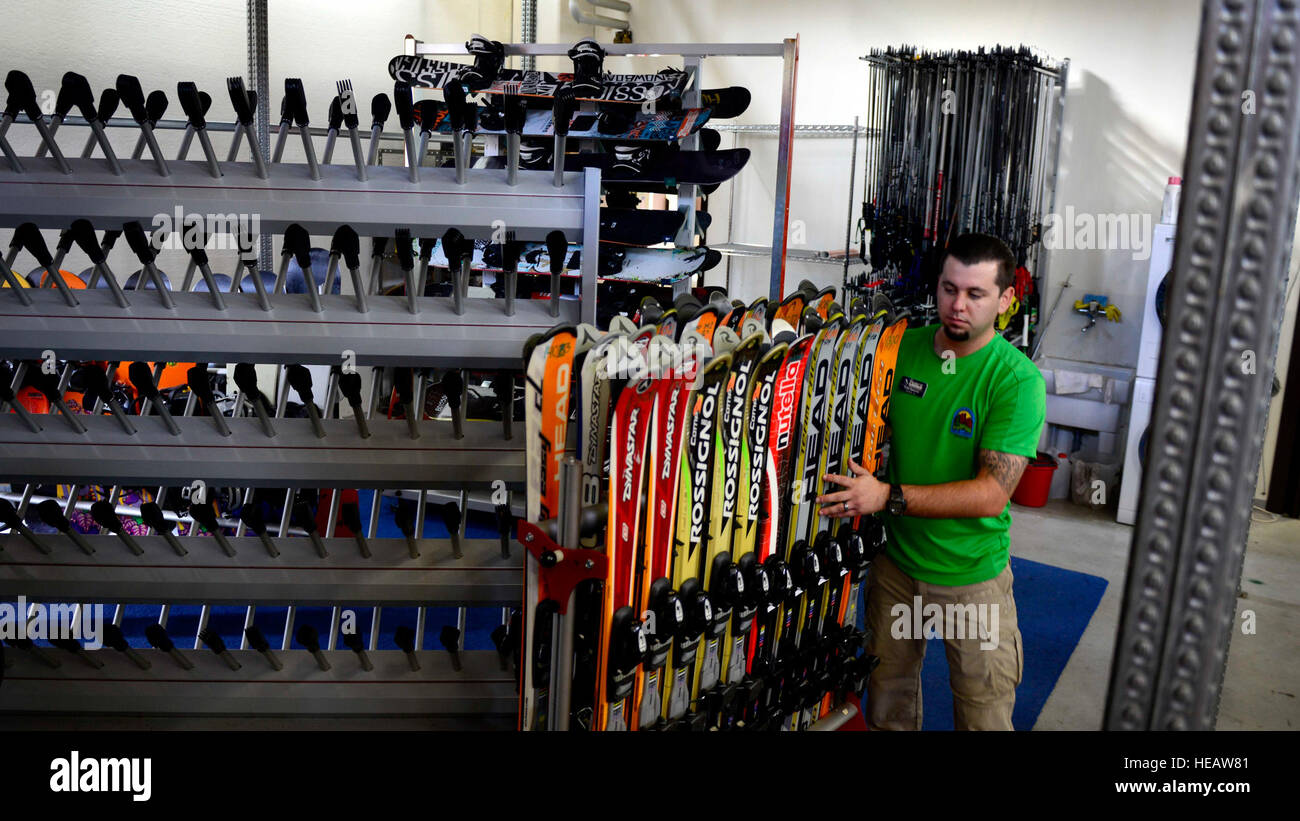Todd Spencer, 31st Force Support Squadron Outdoor Recreation facility operator, rearranges equipment in preparation - Stock Image