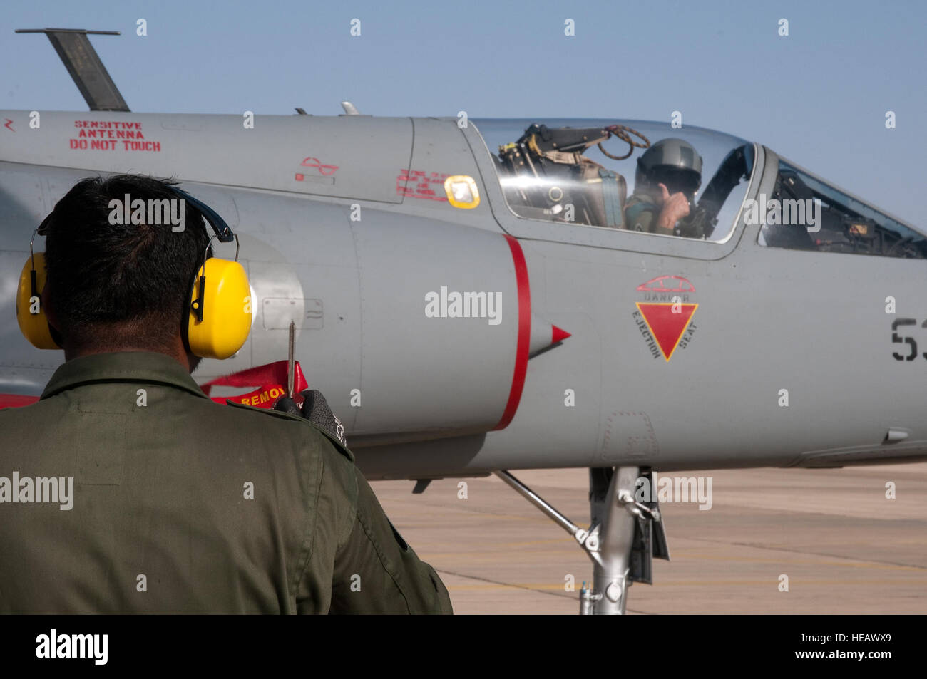 A Pakistani pilot in a Mirage aircraft gives a hand signal in the alert scramble competition during Falcon Air Meet Stock Photo