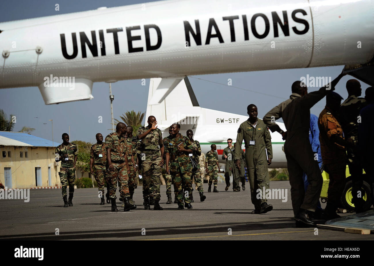 Airmen from multiple African countries walk out to a United Nations Mi-17 helicopter during the U.S. Air Forces - Stock Image