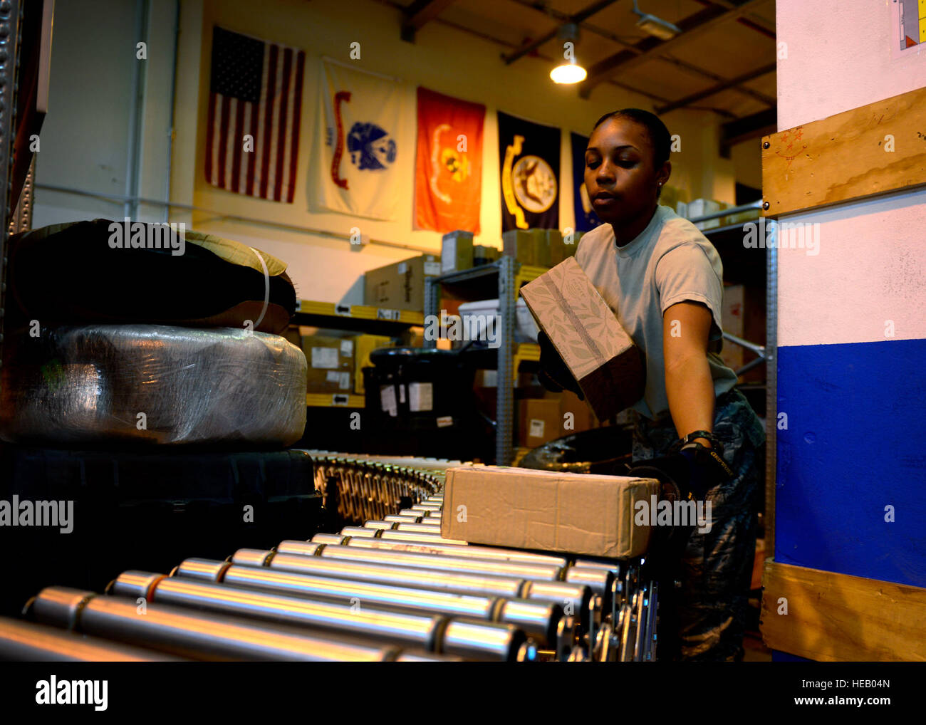 U.S. Air Force Airman 1st Class Keasha Carter, 31st Communications Squadron postal clerk, unloads mail, July 1, - Stock Image