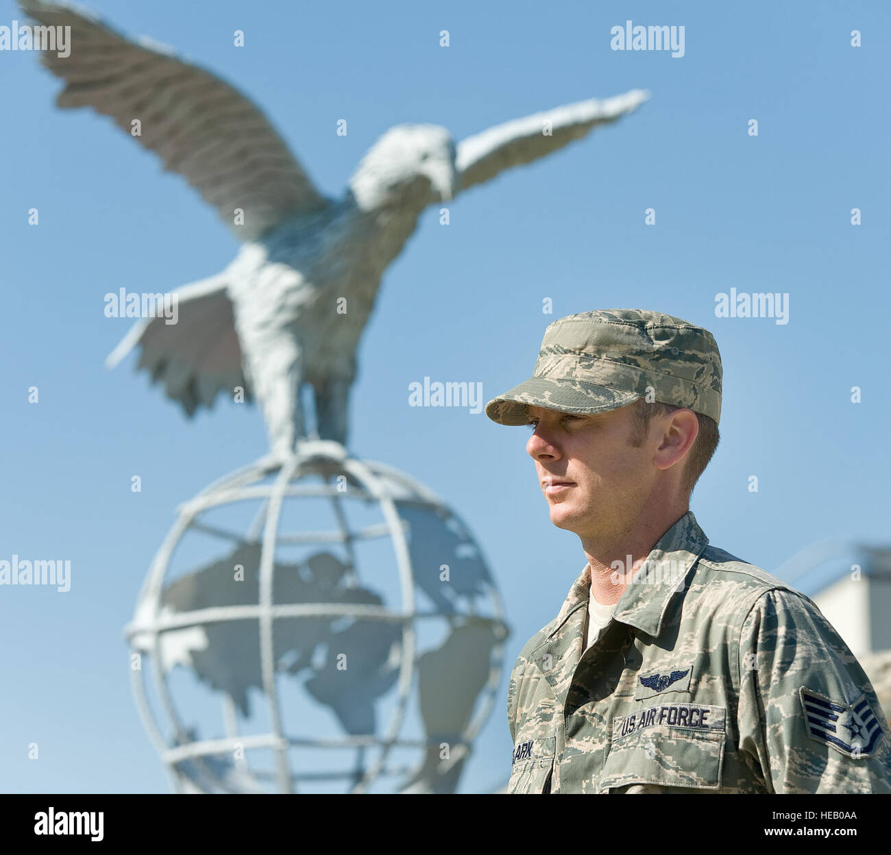 Staff Sgt. Matthew Clark, a loadmaster with the 3rd Airlift Squadron, stands at parade rest during the prisoner - Stock Image