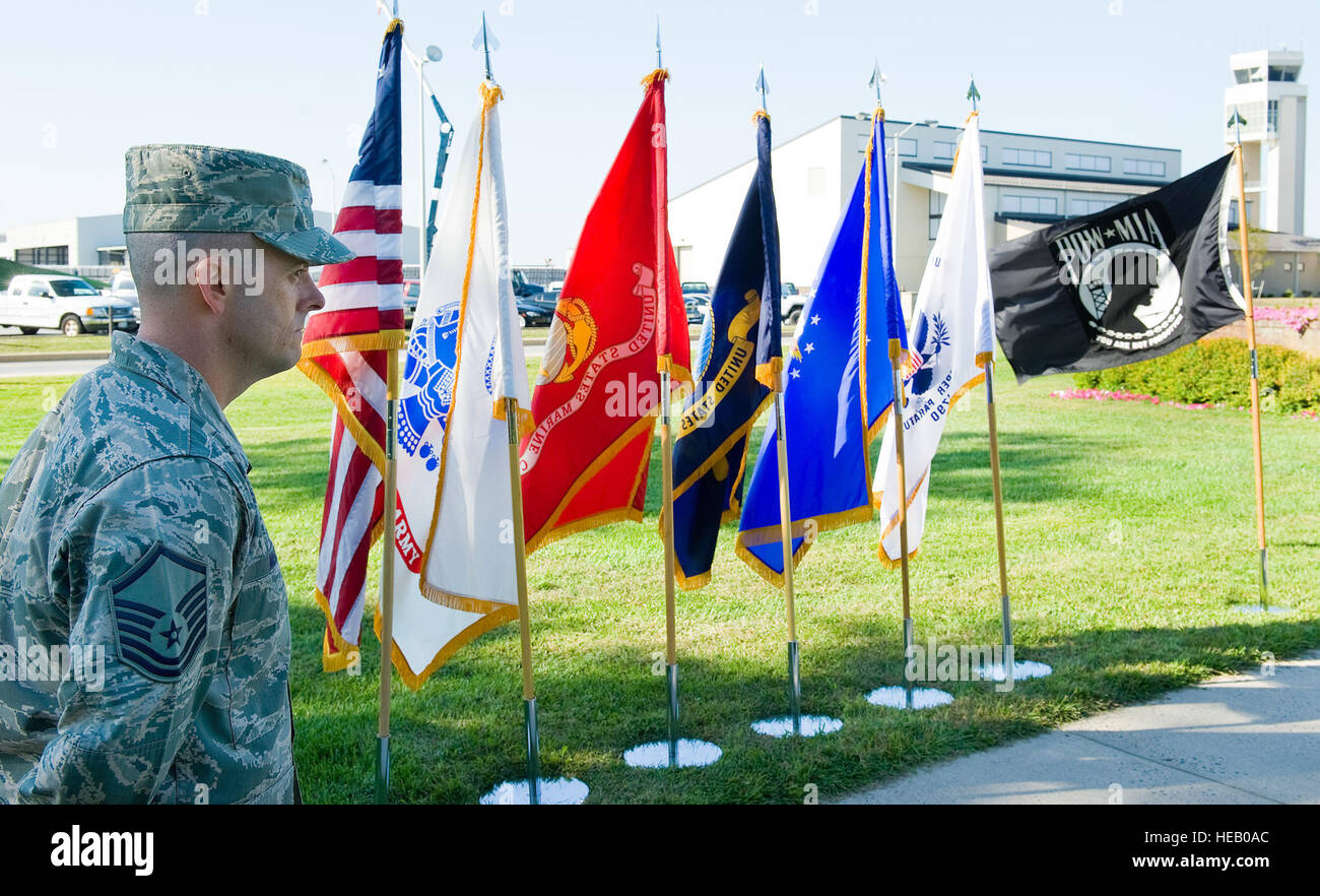 Master Sgt. Bryan McCoy, 436th Operations Support Squadron, stands at parade rest during the prisoner of war/missing - Stock Image