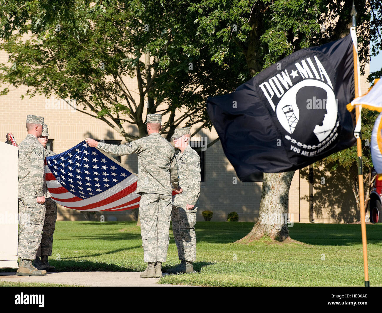 Members of the Dover Air Force Base Honor Guard fold the U.S. flag during a prisoner of war/missing in action ceremony - Stock Image