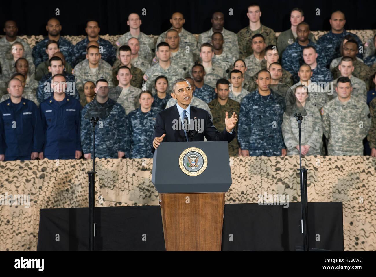 President Barack Obama delivers remarks Dec. 15, 2014, on Joint Base McGuire-Dix-Lakehurst, N.J. Obama expressed Stock Photo