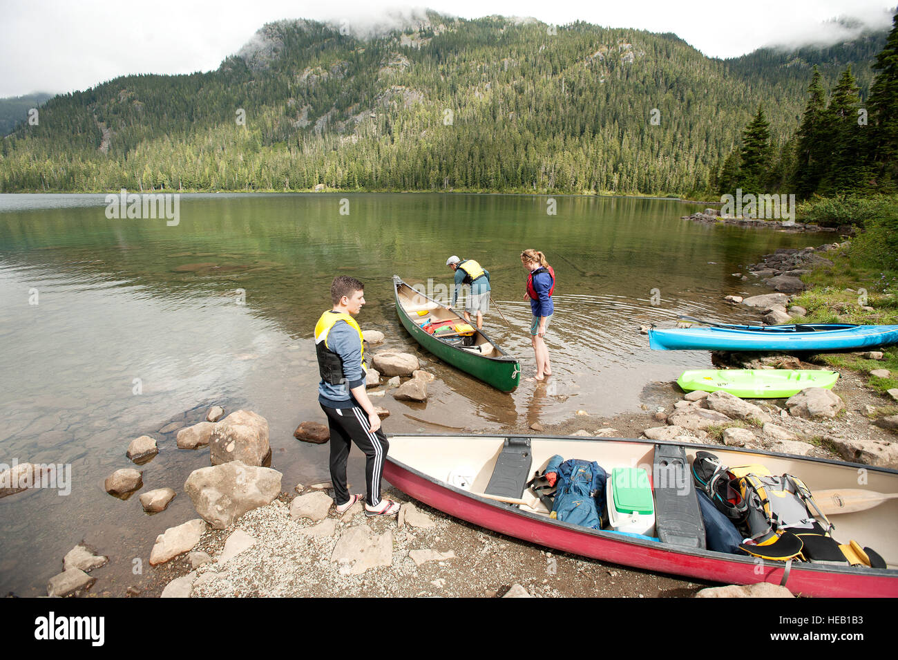 A group of canoe campers push off for a trip across Callaghan Lake Saturday afternoon.  Camp Whistler BC, Canada - Stock Image