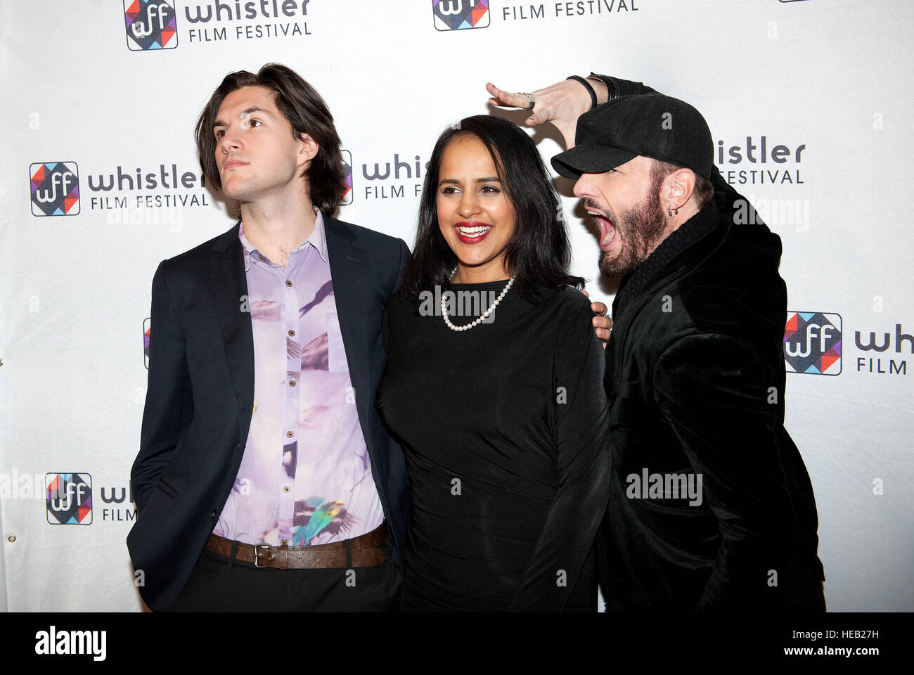 Actors Charlie Kerr, Agam Darshi, and Michael Ellund walk the red carpet on the opening night of the Whistler Film - Stock Image