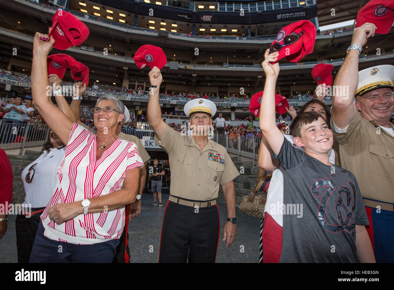 Commandant of the Marine Corps Gen. Robert B. Neller waves his hat during a baseball game at Nationals Park, Washington, Stock Photo