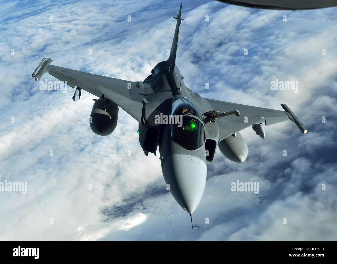A Swedish JAS-39 Gripen returns to the play areas of the Arctic Challenge exercise Sept. 24, 2013, over Norway, Stock Photo