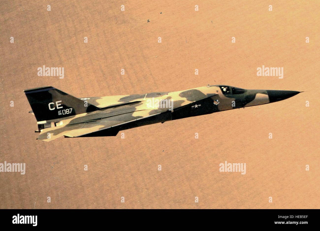 Side view of General Dynamics F-111D (S/N 68-087), from Cannon Air Force Base, N.M., with wings swept in February - Stock Image