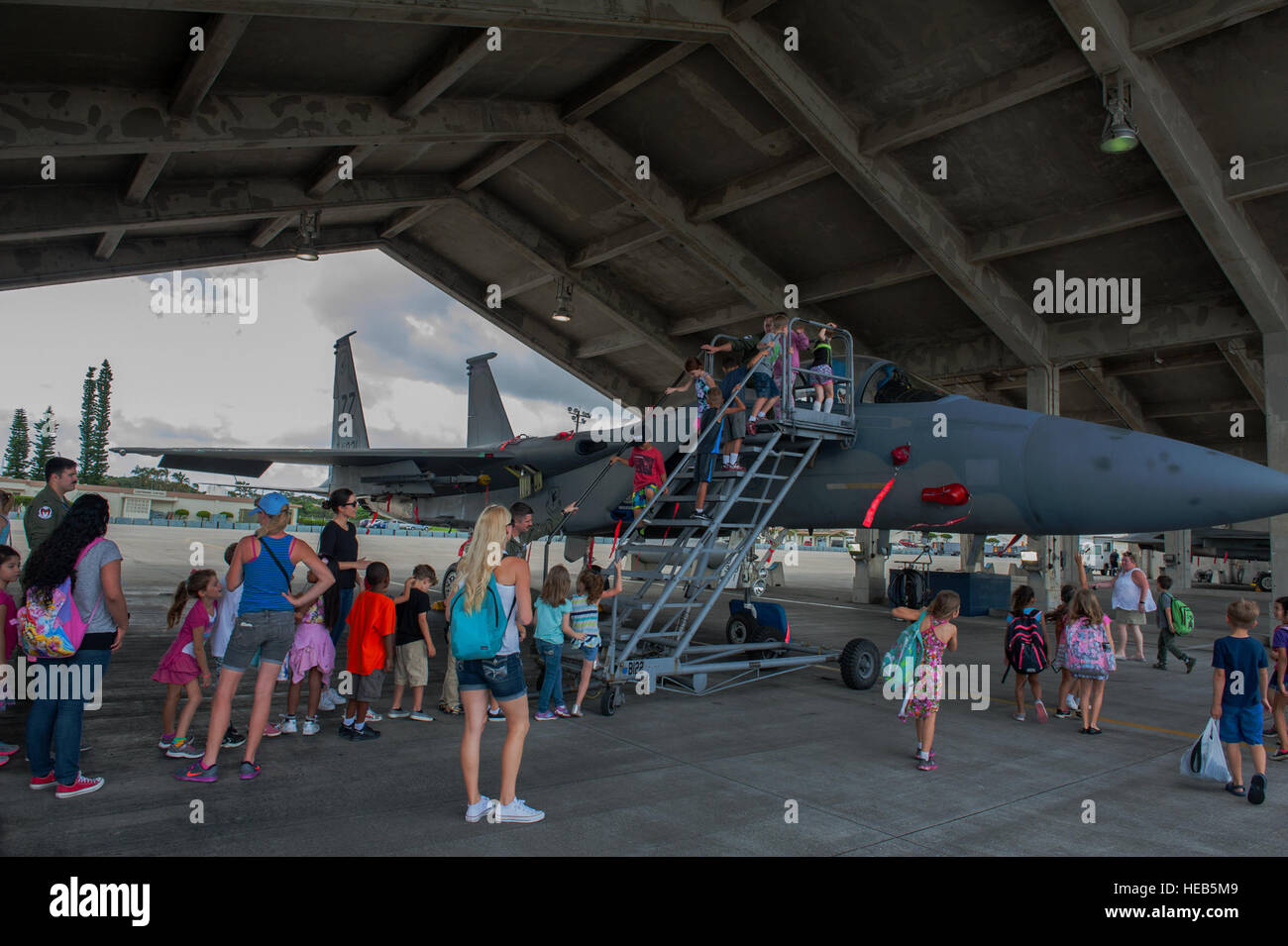 Students, parents, and staff from Bechtel Elementary School tour a 44th Fighter Squadron F-15 Eagle during a career - Stock Image