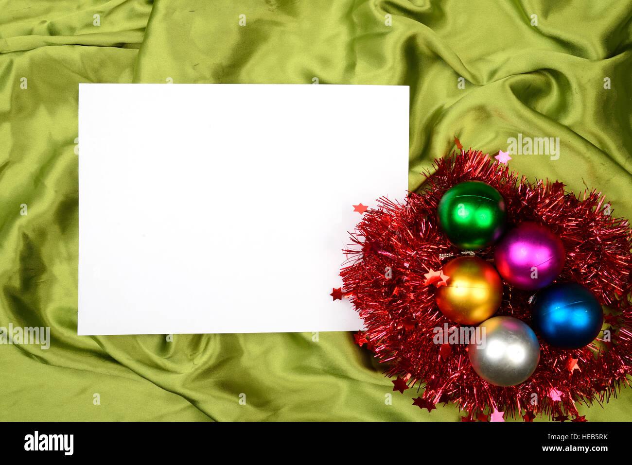 Christmas ball on the green satin background. Christmas background ...