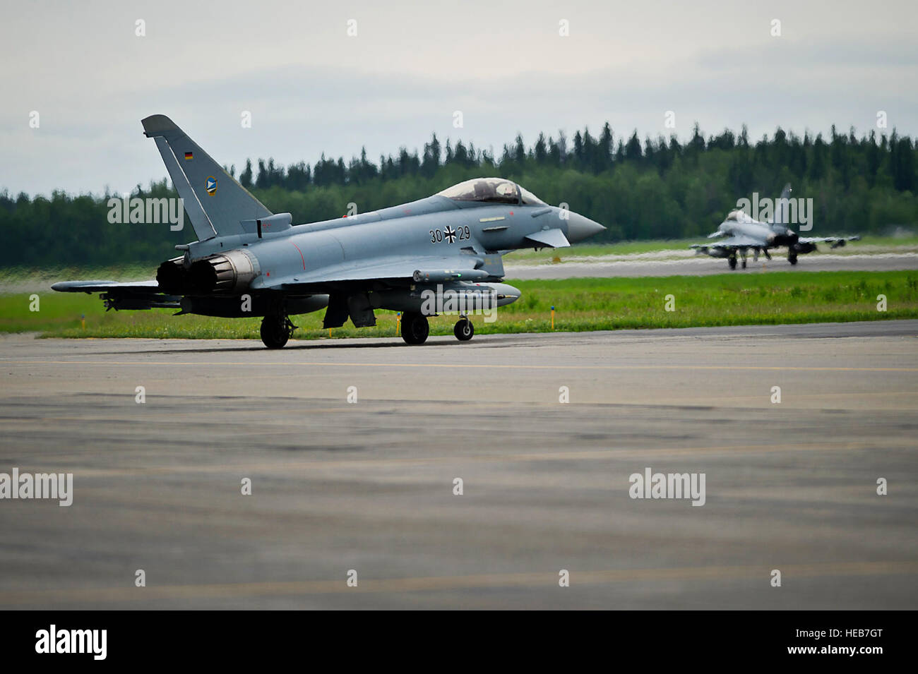 Two German air force Eurofighter Typhoon's taxi on the flight line toward the runway at Eielson Air Force Base, Stock Photo