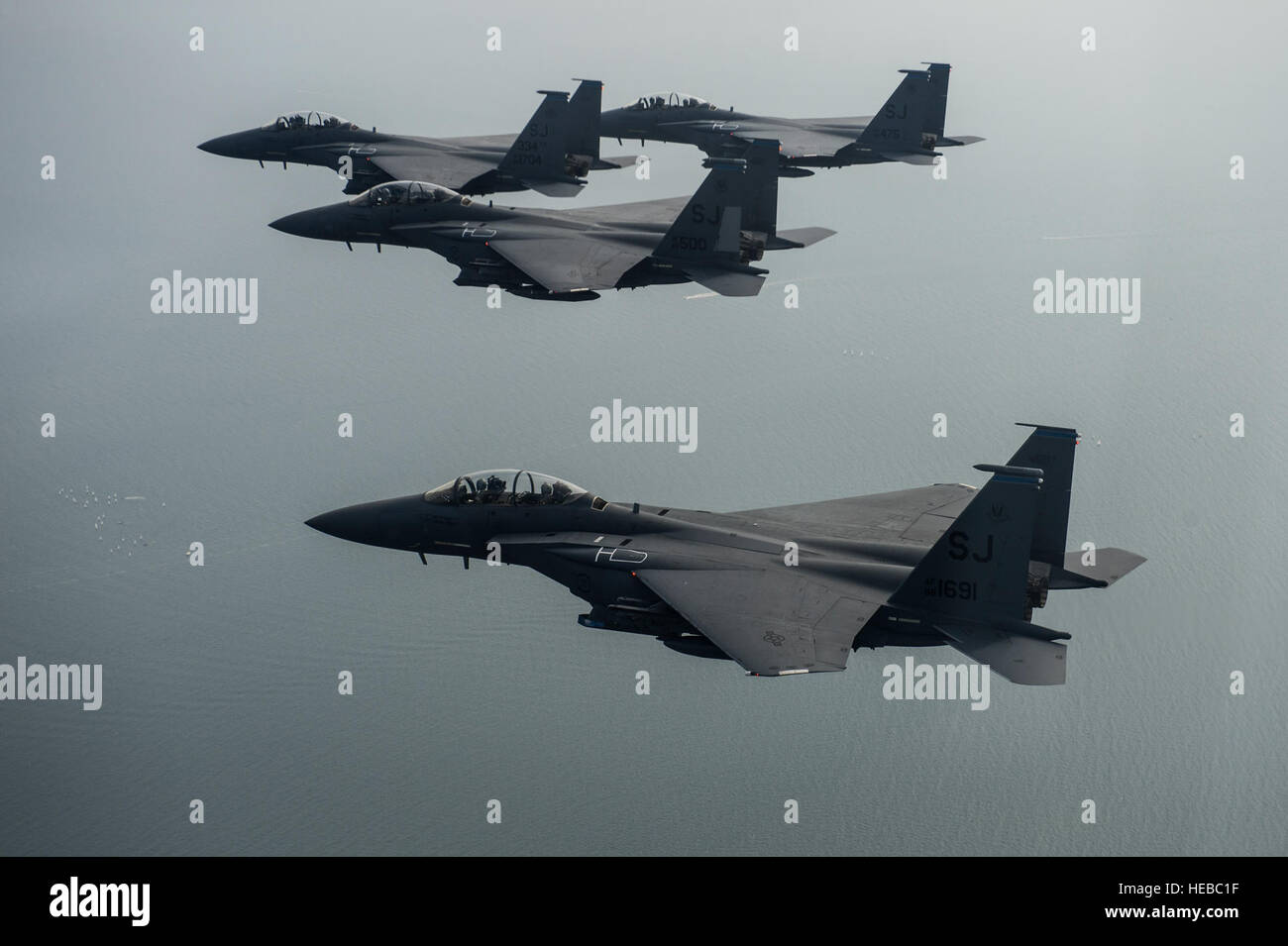 F-15E Strike Eagles assigned to the 334th Fighter Squadron at Seymour Johnson Air Force Base, N.C., fly over New - Stock Image