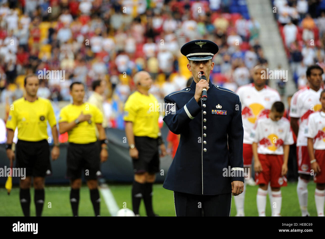A U.S. Air Force member sings the National Anthem before a Major League Soccer match as part of Air Force Week 2012 - Stock Image
