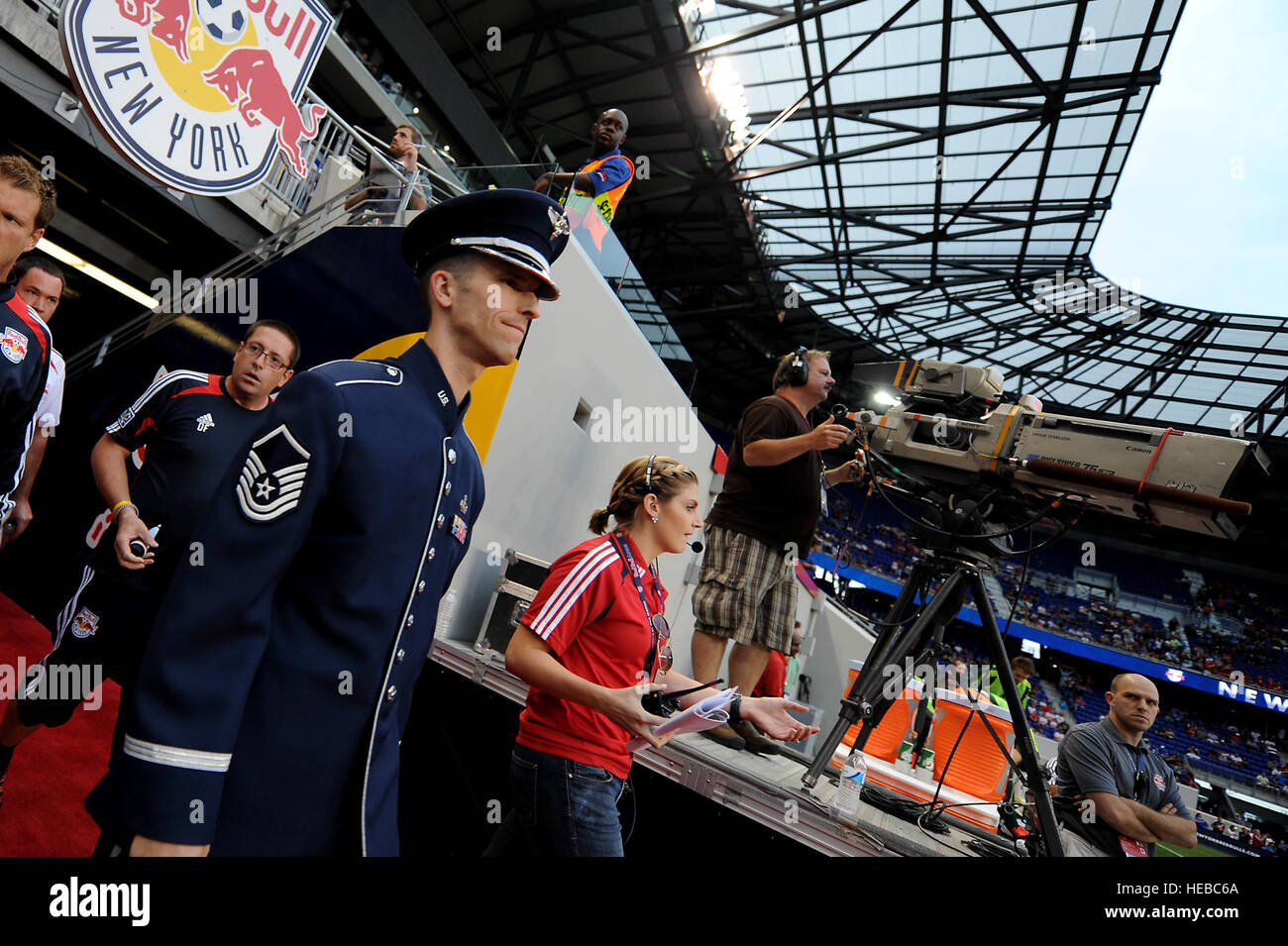 A U.S. Air Force member prepares to sing the National Anthem before a Major League Soccer match as part of Air Force - Stock Image