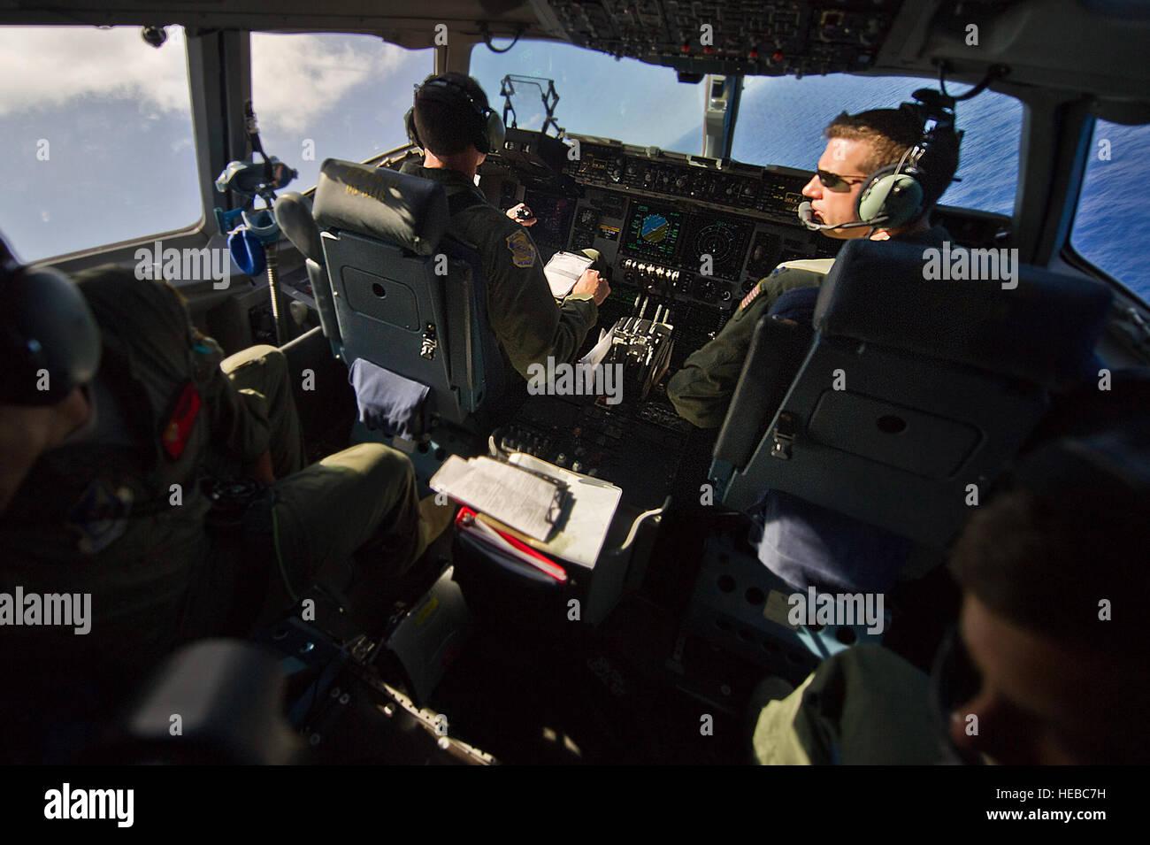 U.S. Air Force Capt. Brian Pollock, 535th Air Lift Squadron, C-17 Globemaster III pilot, flies a combat training - Stock Image