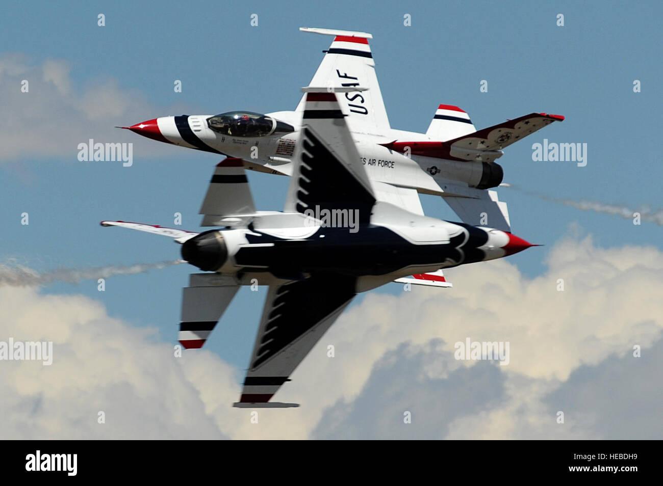 U.S. Air Force Maj's. Blaine Jones, Thunderbird 5, Lead Solo and Jason Curtis, Thunderbird 6, Opposing Solo, perform Stock Photo