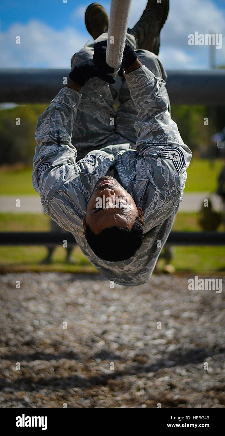 Tech. Sgt. Eric Dagin pulls himself across a rope obstacle March 3, 2015, at the Hillsborough County SheriffÕs Office Stock Photo