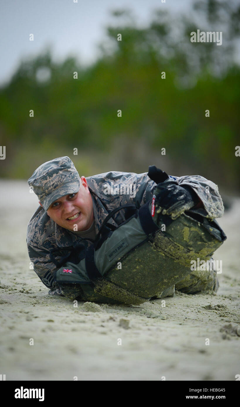 Staff Sgt. James Matheny, Joint Communications Support Element cyber transport craftsman, low crawls during a physical Stock Photo