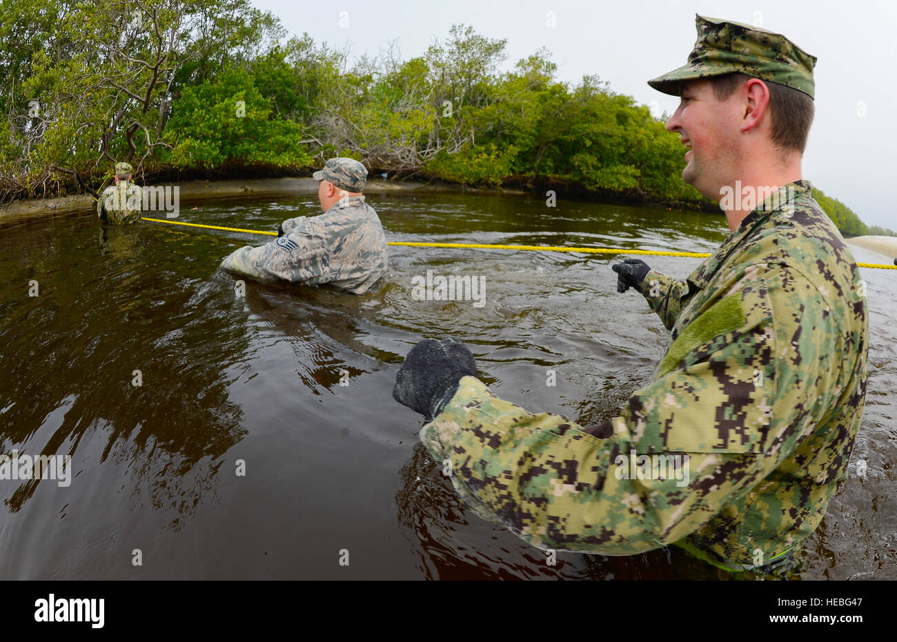 Members from the Joint Communications Support Element cross an inlet on MacDill Air Force Base, Fla., March 2, 2015. Stock Photo