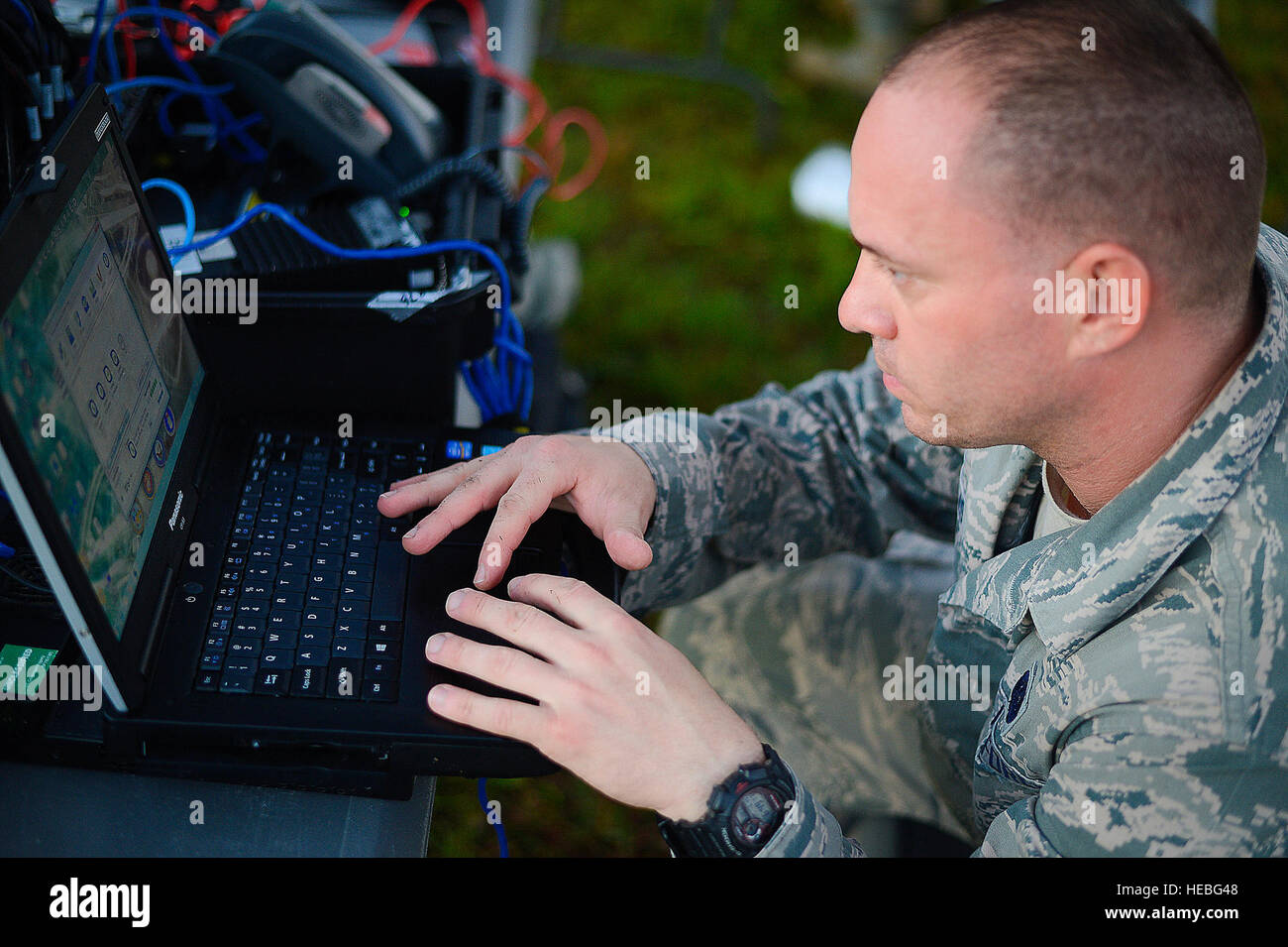 Senior Airman Rob Carlisto, Joint Communications Support Element cyber support, establishes communications during Stock Photo
