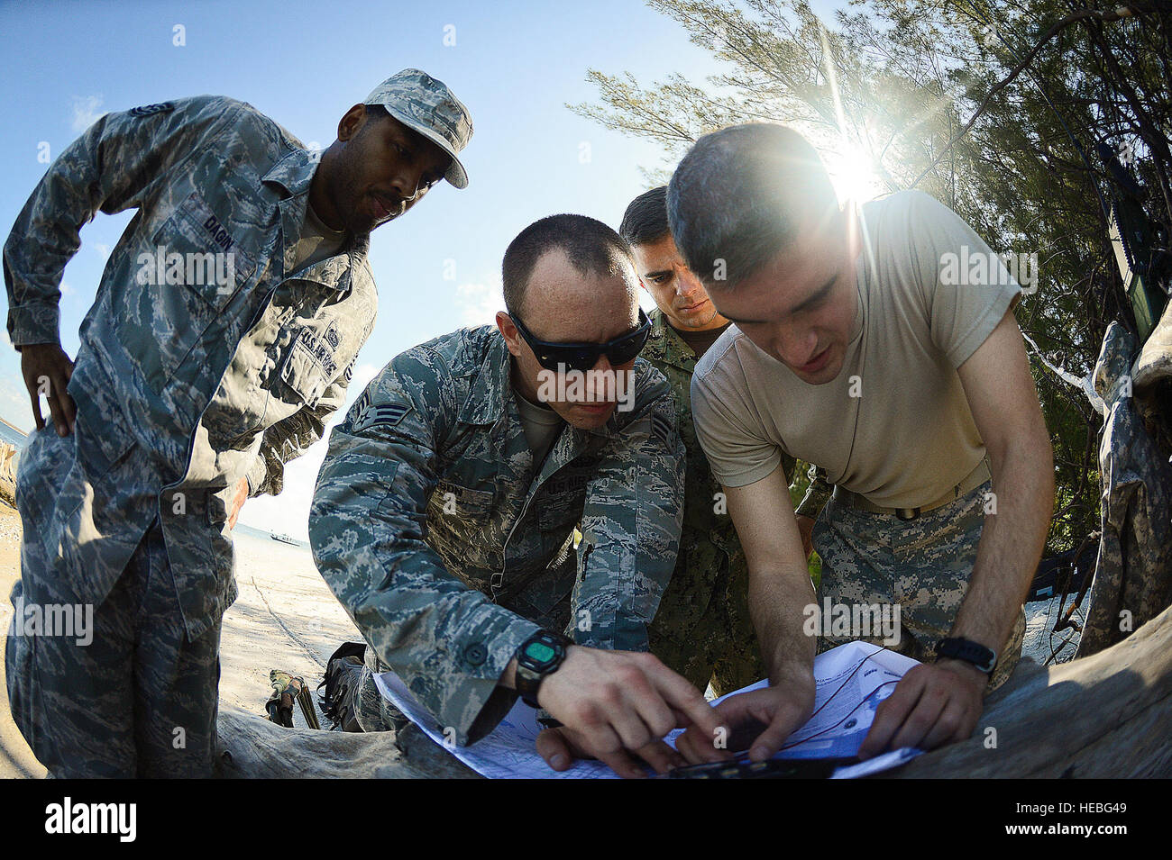 Members of the Joint Communications Support Element assess a map for the best communications establishment while Stock Photo