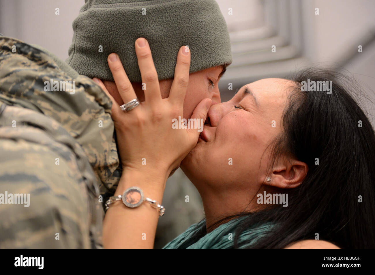 Capt. Joe Faraone reunites with his wife, Suk, Jan. 15, 2014, at Spangdahlem Air Base, Germany, The Airman returned Stock Photo