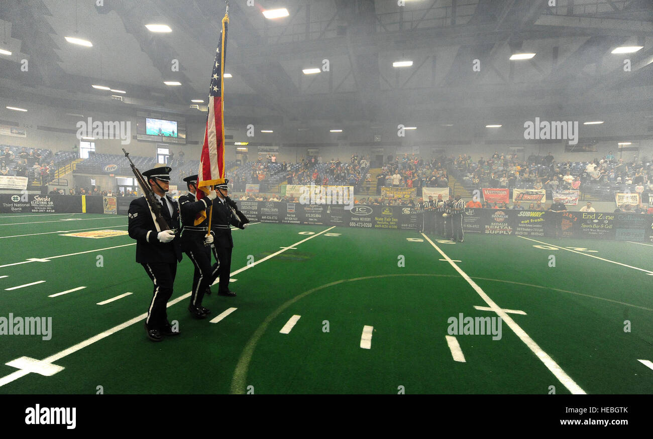Ceremonial Guardsman from the 509th Bomb Wing Honor Guard march onto the field to present the colors during the - Stock Image