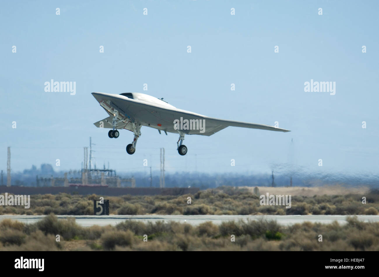 A Navy X-47B Unmanned Combat Air System Demonstration aircraft takes off and flies for the first time Feb. 4, 2011, Stock Photo