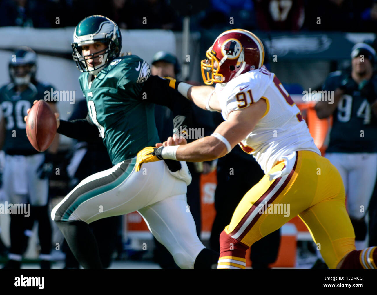 Washington Redskins outside linebacker Ryan Kerrigan attempts to sack Philadelphia Eagles quarterback Nick Foles - Stock Image