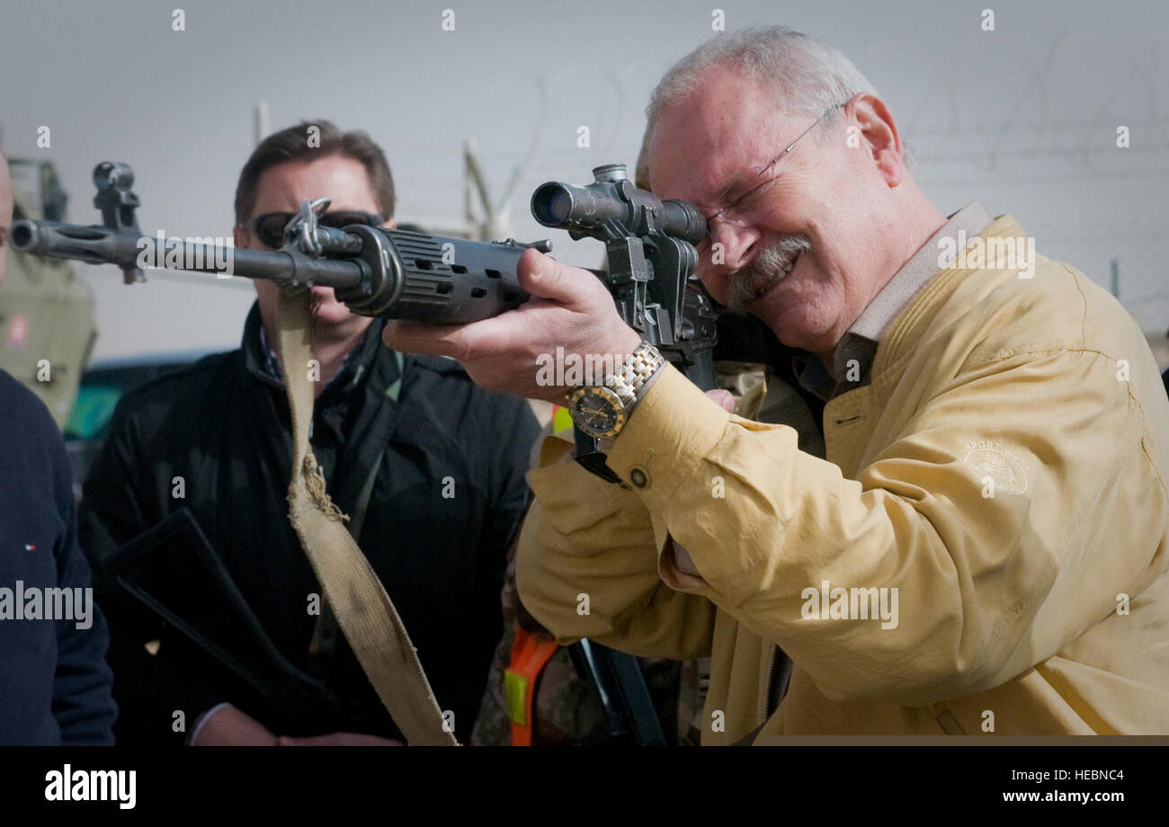 Slovak President Ivan Gasparovic looks through the scope of