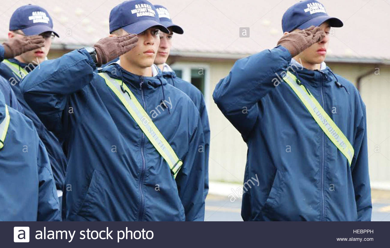 Alaska Military Youth Academy cadets salute during a uniform inspection. The AMYA Challenge program is a 17.5 month, - Stock Image