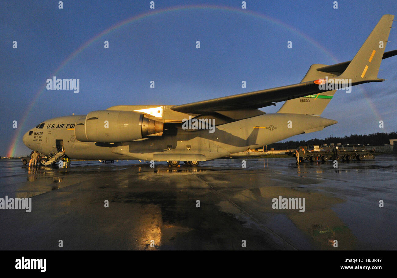 A Rainbow Appears In The Sky Framing A Us Air Force C 17 Stock