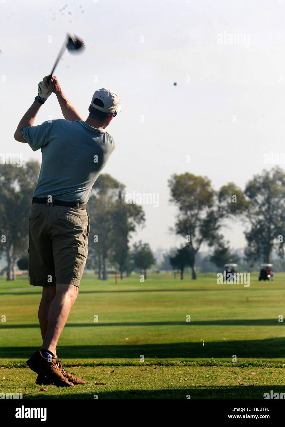 Col. Chris Craige, 39th Air Base Wing commander, tees off the first ball during the second annual Air Force Assistance - Stock Image
