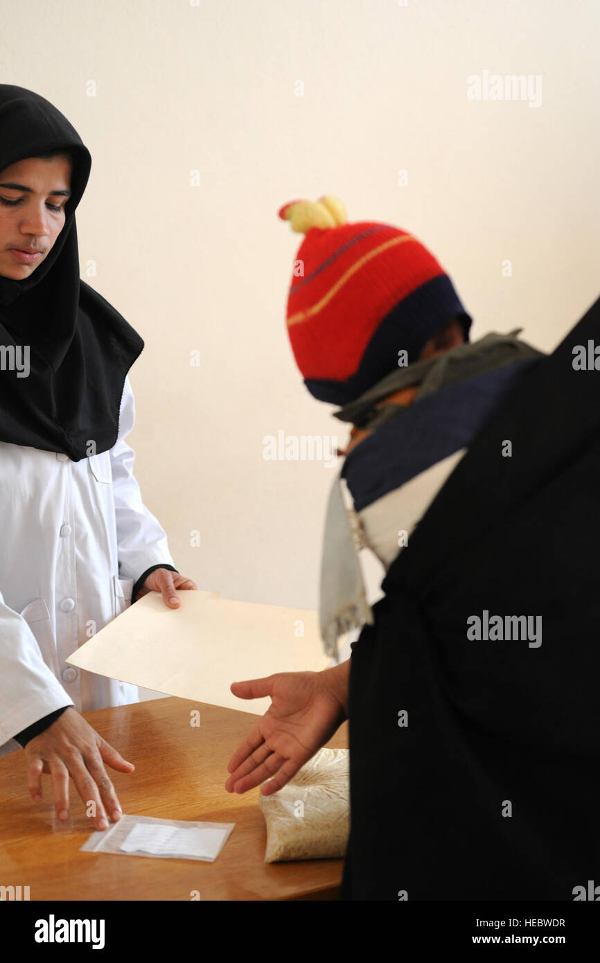 Every week, Shakeryah Azimi and other medical personnel at Farah Hospital screen new patients and track the progress - Stock Image