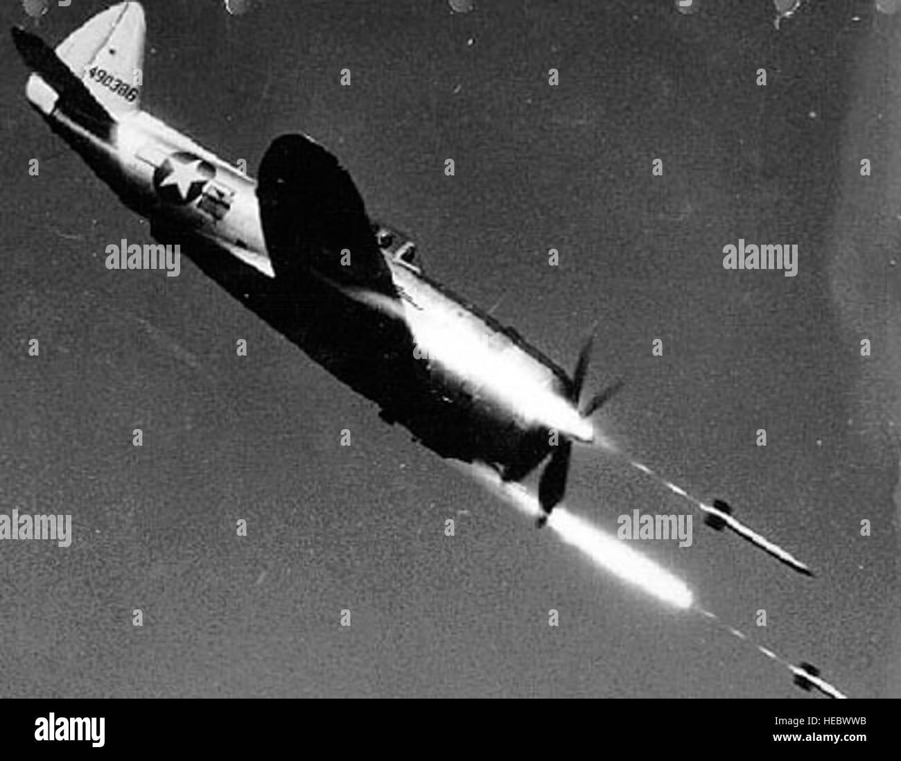 Republic P-47D-40-RE in flight firing rockets (S/N 44-90386)  (U S