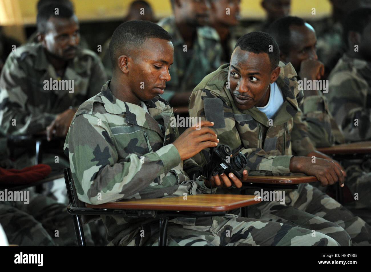 Djiboutian army soldiers discuss a set of PVS-7 Night Vision Goggles during an NVG class in Arta, Djibouti, on March Stock Photo