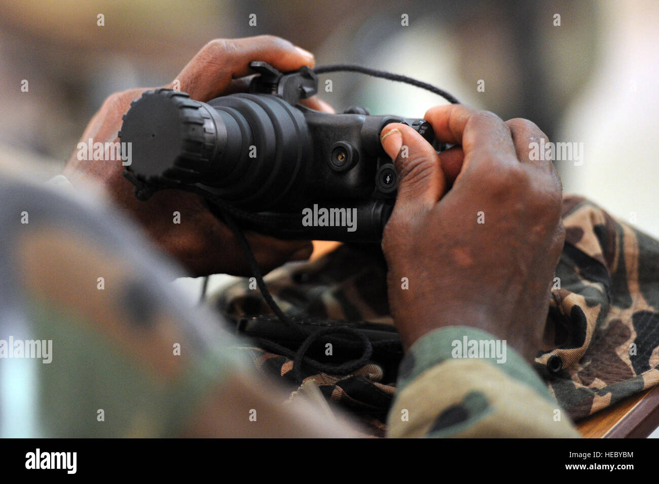 A Djiboutian army soldier turns on a set of PVS-7 Night Vision Goggles during a NVG class in Arta, Djibouti, on Stock Photo