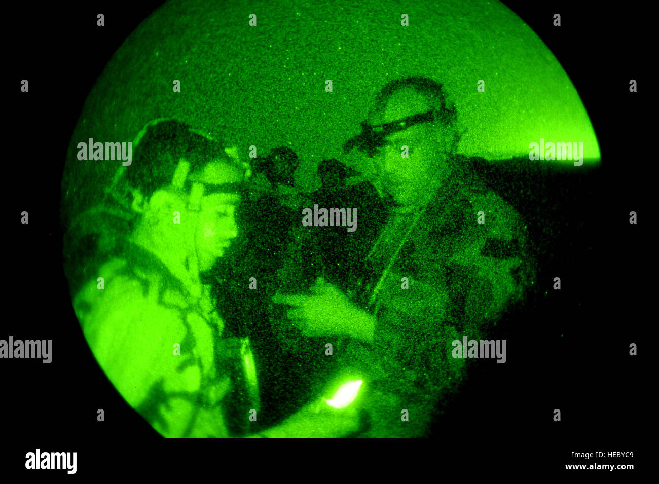 Two Djiboutian army soldiers discuss their PVS-7 Night Vision Goggles during a night vision goggle class in Arta, Stock Photo