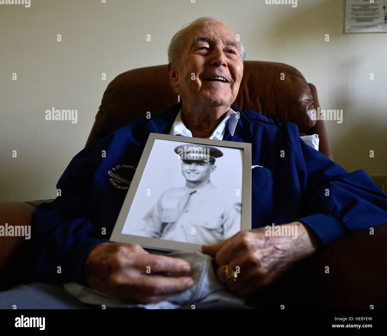 Retired Col. Ralph Parr holds a portrait of himself as he looks toward the window of his room. Parr joined the Army Stock Photo