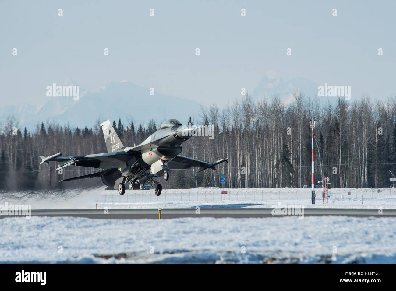 An F-16 Fighting Falcon takes off during a training sortie April 3, 2014 at Eielson Air Force Base, Alaska. Regular Stock Photo