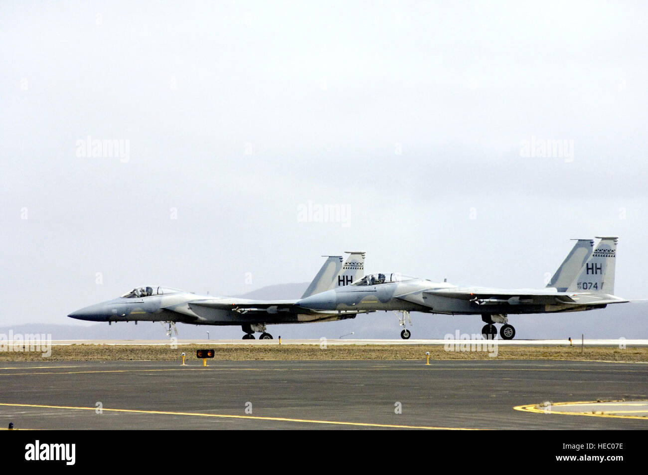 F 15 eagles wait to take off from naval air station keflavik stock f 15 eagles wait to take off from naval air station keflavik iceland on monday may 22 2006 airmen and sailors are reducing operations after more than freerunsca Images