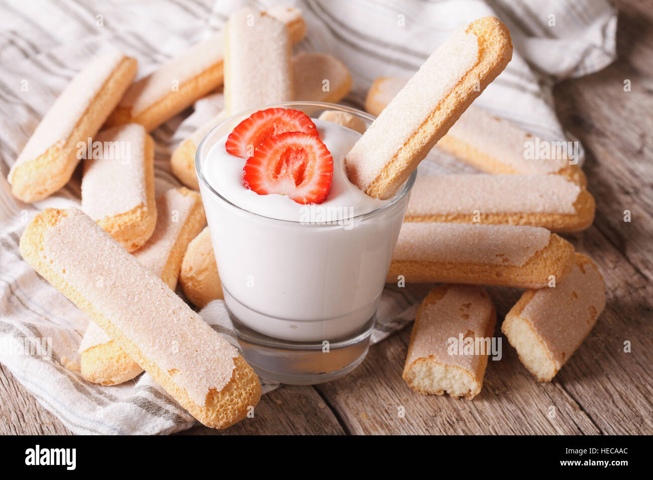 Dessert of Savoiardi with yogurt and strawberries. horizontal - Stock Image