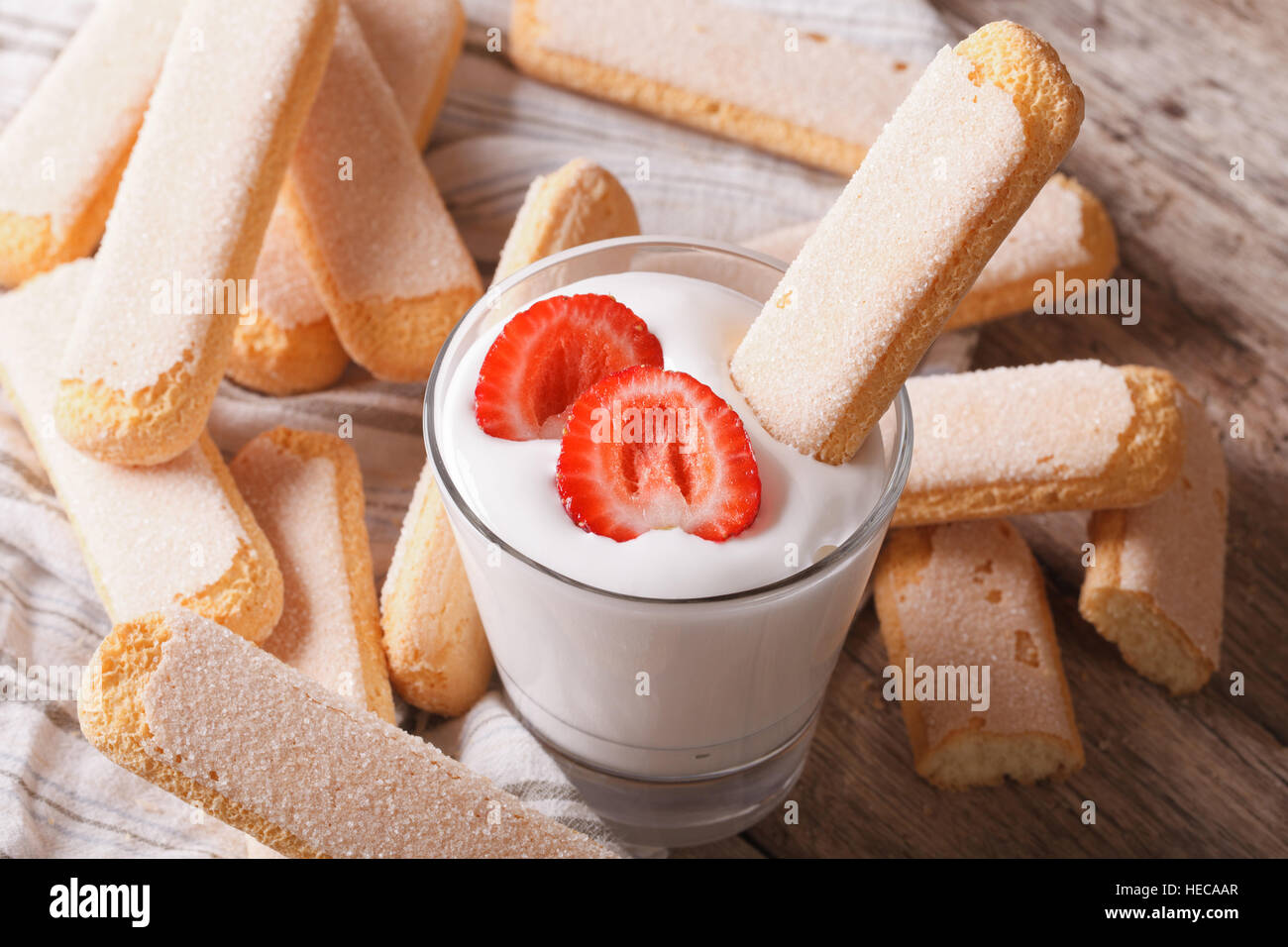 Savoiardi and whipped mascarpone with strawberries closeup. horizontal - Stock Image