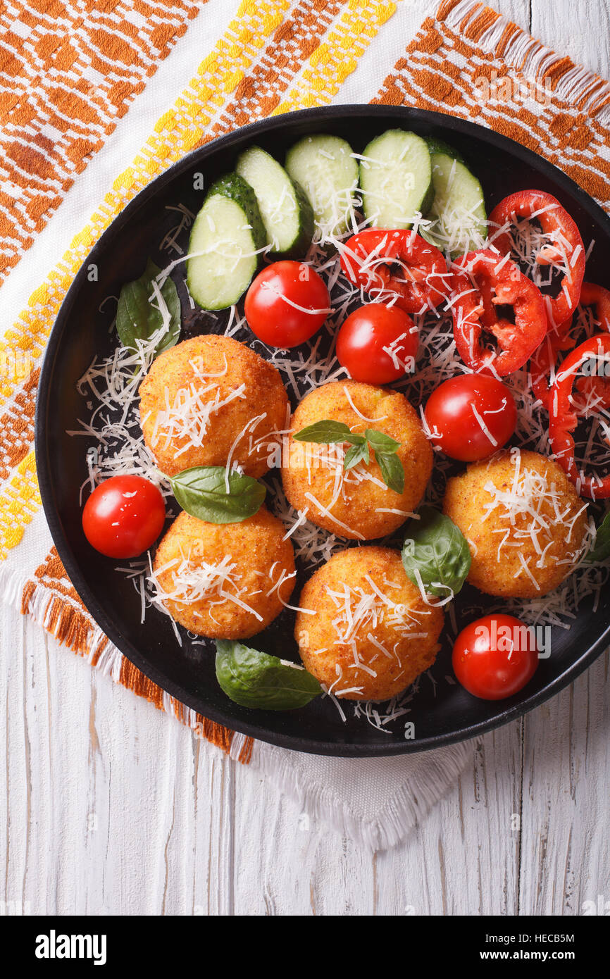 Italian arancini rice balls with cheese and fresh ...
