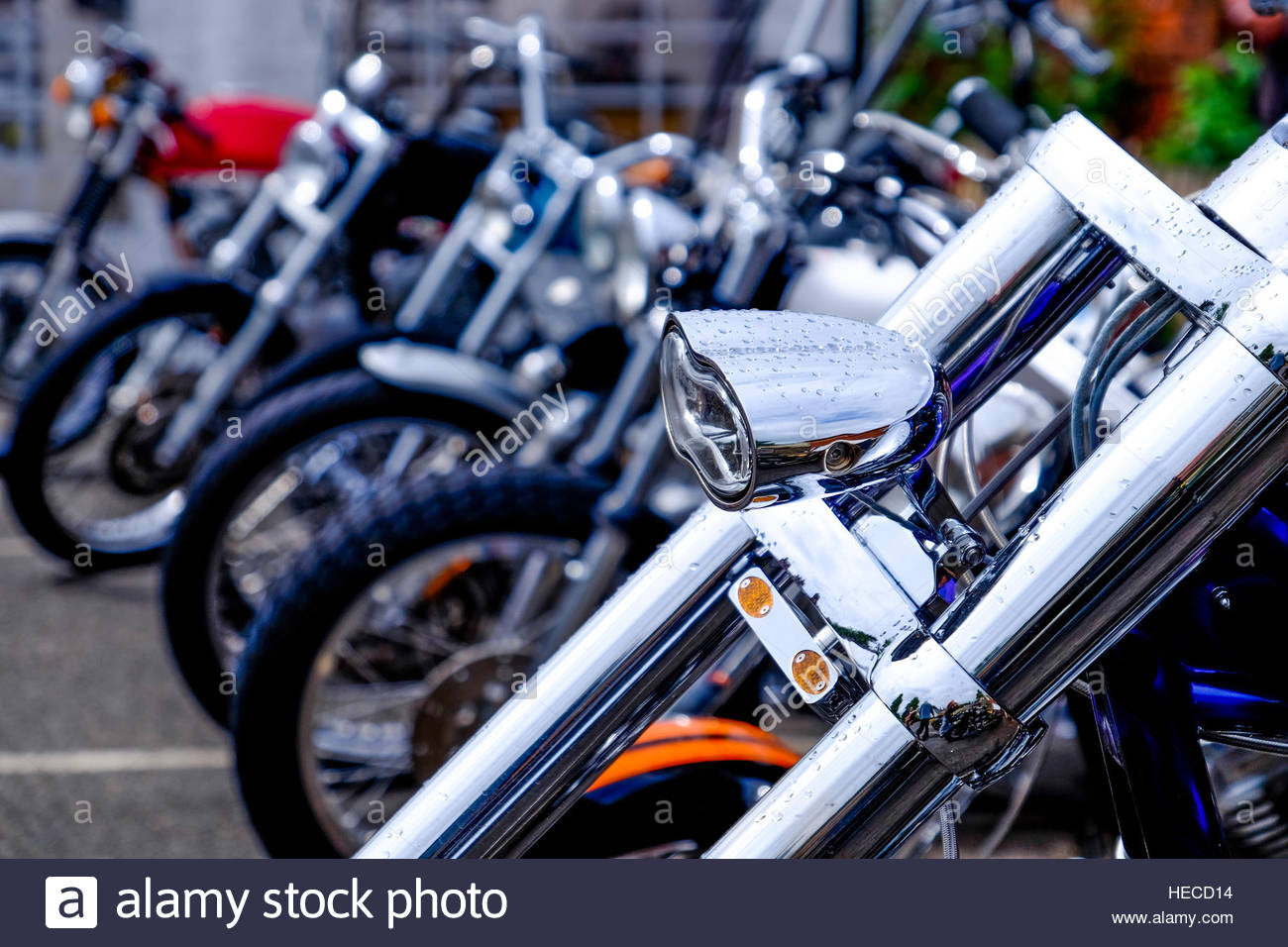 Motorcycles parked at a biker's event. - Stock Image