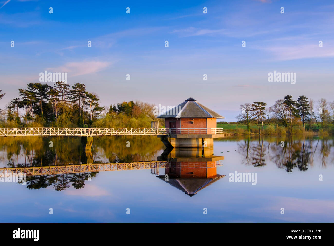 View over Cropston reservoir and the draw off tower and gantry. Leicestershire, UK. - Stock Image